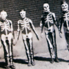 vulpines: four guys in skeleton costumes holding hands. (human wreckage)