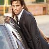 charming_thief: (cuffed against the car)