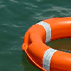 muccamukk: An orange life ring floating in the sea. (Lights: Lifering)