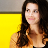starrylizard: Actress who plays Riley smiling with yellow background (NT - Riley Intelligence Yellow)