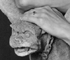 alfreda89: 3 foot concrete Medieval style gargoyle with author's hand resting on its head. (Oxblood Lilies)
