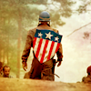 failing_light: Chris Evans as Captain America walks away from the camera with the USO shield on his back. (o captain my captain)