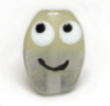 kalorlo: a smileyface glass bead, looking up and left (Default)