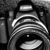 crazyscot: Black and white close-up of a DSLR with long lens (photography)