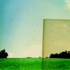 ext_2359631: Tinted glass covering a corner of a picture of a meadow (filter)