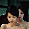 """evewithanapple: hideko and sook-hee circle each other   <lj user=""""evewithanapple""""</lj> (hand   raise me to your lips)"""