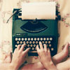 shiegra: someone's hands on a typewriter with a blank sheet of paper inserted (there's nothing to writing)