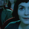 skye_writer: Cropped cap of Amelie in a movie theater from the film Amelie. (watching movies)