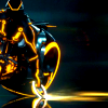 skye_writer: Cropped cap of Clu from TRON: Legacy on a lightcycle, disc out. (lightcycle clu)