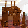 azurelunatic: A truly impressive fort made out of cardboard boxes, large enough for several friendly adults to walk inside. (Boxlandian Empire, boxfort)