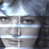 circular_time: Nyssa's face seen through the grill of a Dalek's head. (dalek)