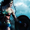 monanotlisa: Diana of Themyscira, side profile, on the battlefield, holding her shield, blue sky in the background. (diana fight - wonder woman)