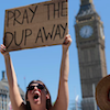 "cloudsinvenice: A woman protests at Westminster, holding up a sign that says ""Pray the DUP away"" (politics - pray the DUP away)"