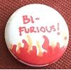 """redbird: a pin with the text """"Bi-Furious"""" above a drawing of flames. (bi-furious)"""