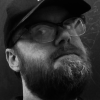 ext_2384642: Black-and-white photo of me wearing a cap (Default)