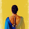 muccamukk: Diana from the back, in fancy dress with her sword sheathed along her spine. (WW: Sword)
