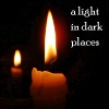 "darchildre: a candle in the dark.  text:  ""a light in dark places"". (Default)"