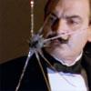 lyssie: (Poirot inspects a mirror)