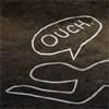 "next_to_normal: A chalk outline of a dead body with a speech bubble that says ""ouch"" (ouch)"
