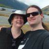 crazyscot: Selfie, with C, in front of an alpine lake (couple)
