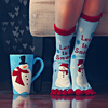 wubomei: feet wearing snowman socks next to a matching cup (christmas socks and cup)