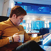 aurumcalendula: Kirk holding a mug and looking at reports (Kirk and caffeine)