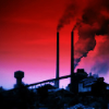 thiefofvoices: a factory with smokestacks silhouetted against a red sky (the industrial park)
