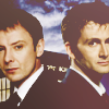 daphnie_1: The Doctor and the Master standing back to back in front of the TARDIS. (DW | D&M | TARDIS)
