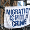 "cloudsinvenice: a sheet hanging from scaffolding with ""migration is not a crime"" painted on it (migration: sheet)"