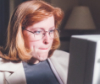 cassyblue: woman at computer looking perplexed (scully)