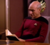 cassyblue: bald man reads off tablet (reading, picard)