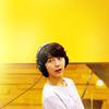 via_ostiense: Eun Chan with headphones, yellow background (Music)