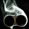 sarcasticsra: A shotgun barrel with smoke on a black background. (stock: gun with smoke)