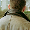 dulcinea: Dean Winchester's back, featuring his leather jacket's popped collar ([SPN] Were you raised in a barn?)