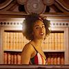 muccamukk: Bill standing in front of the TARDIS bookshelf. (DW: Queen of Books)