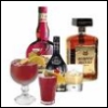 thnidu: several bottles and glasses of various good alcohols (drinks)