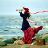 auroracloud: a woman by the sea shore, looking out to sea with a telescope, her skirt blown by the wind (red lady by the sea)