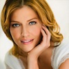 intheheart: A picture of Tricia Helfer in a white shirt, chin in her hand, looking at the camera. (in the heart : gina : Tricia Helfer)