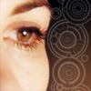 st_aurafina: 13th Doctor's eye, with Galifreyan text in the background (dw: 13's eye)