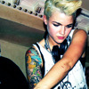 watershoes: (fierce tattoed dj lady)