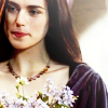 ext_30194: Katie McGrath as Morgana on BBC's 'Merlin', smiling with flowers (DW - [Amy] glorious curious confusion)