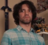 musicalraven: Dan Avidan, a male with curly black hair and wearing plaid, looking off camera wide eyed (Dan, Dan avidan, Game Grumps, GG)