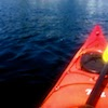 ironymaiden: POV image of kayak bow with paddle at rest on a lake (kayak)