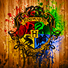 katmarajade: Hogwarts shield with paint splatters in house colors (interhouse 2017)