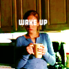 "katmarajade: Woman drinking coffee with words ""wake up"" over her face (Default)"