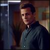 notgivingyourmoneyback: Harvey Specter standing center frame wearing a dark button-up shirt. ([neu] casual dark shirt)