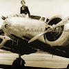 runpunkrun: amelia earhart sitting on the nose of her plane, text: like icarus ascending (on beautiful foolish arms)