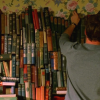skye_writer: Cropped screencap of Ned from Pushing Daisies shelving books. (books books books)