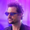 mlravenwrites: Head-and-shoulders shot of Three wearing sunglasses. The background and entire image are tinted purple. (Default)