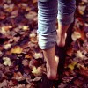 recessional: bare-footed person in jeans walks on log (film; one badass chick)
